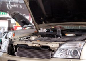 car in shop being repaired